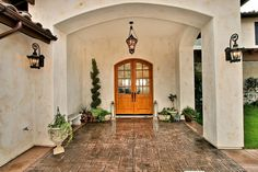 Bring summer to your front door with these curb appeal ideas. Add lighting, front door color, landscaping & more for a welcoming front entry. Arched Front Door, Double Front Entry Doors, Entry Doors With Glass, Arched Doors, House Front Door, Front Porch, Mediterranean Front Doors, Mediterranean Homes, Front Door Colors