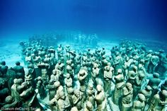 Artist Jason deCaires Taylor known for sculpting pieces of art and then lowering them into the ocean
