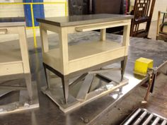 Metro Luxe's Side Console, 819-767,in Smoke on top and base and Silk in the middle. Century Furniture chest nightstand