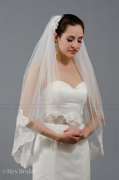 2 tier bridal wedding veil elbow alencon lace trim  by alexbridal, $79.99 I really like this I know it's prolly old fashioned but I think its very simple and Beautiful.