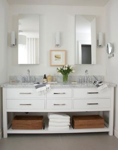 Restoration Hardware vanity.  mirrors not centered on wall; this is the prob I would have