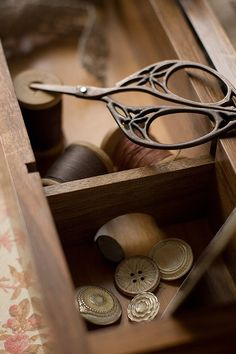 Antique scissors and drawer with cotton and buttons Repinned by www.silver-and-grey.com