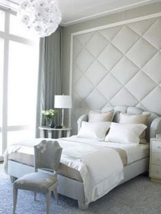 reate a focal point with floor to ceiling headboard.