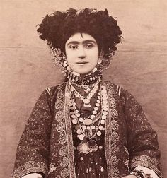 Iranian woman, detail of her magnificent amulet jewelry.