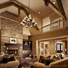 Beams, chandelier, fireplace, wall color - great room. Photo from FauxWoodBeams.com