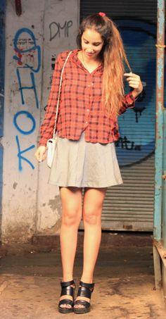 Karen Or, Israeli fashion blogger for Street Chic Tel Aviv, wears a red plaid button down and skater skirt