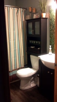 Small bathroom design.. love the dark wood cabinetry, color, I love everything about this bathroom!!! Its my favorite out of all the photos I pinned.