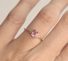 Beautiful simple peach - pink sapphire ring in 14k rose gold. All sapphires are natural so color may vary a bit from peach to pink peach. Product details Gemstone: peach sapphire 0.85 carat, 7 x 5.5mm Quality: VS clarity Treatment: None. Shape: oval Diamonds: VS clarity, G color, non