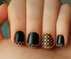Here's another plain black nail design but using some nice gold decorations to give it that extra amount of style.