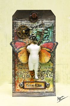 Tag by Ingvild Bolme with Sizzix embossed background and Junkyard Findings metals from Prima