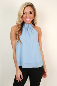 This ruffle top is perfection! It looks lovely with white jeans or shorts and sandals or wedges!
