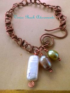 handwrapped copper bracelet w/ natural pearls.  Venice Beach Adornments