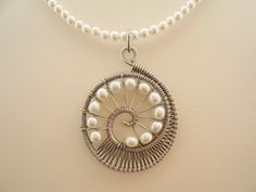 Nautilus Pendant Necklace. $68.00, via Etsy.