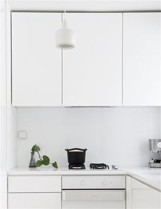 #Scandinavian Retreat: A simple sprig of ivy brings green into the #kitchen #home