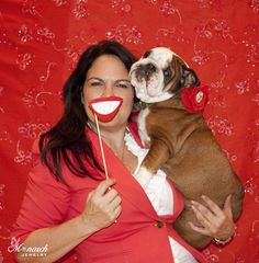 Monarch Jewelry's Christine and Lola ( Piggy) having photo booth fun at Monarch Jewelry's Blog and Bling Event.  The Monarch Jewelry showroom is located in Winter Park, Florida.