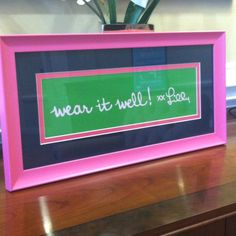 Lilly Pulitzer art made by framing the bottom of a shopping bag. Lilly Lovers are creative!
