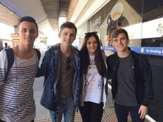 Tyde Levi, Troye Sivan and Connor Franta with a fan.