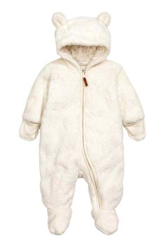 Pile all-in-one suit: All-in-one suit in soft pile with feet and mittens, a hood with sewn-on ears, zip down the front and along one leg and overlapping ribbing at the cuffs that opens up. Jersey lining.