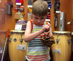 Field Trip to Guitar Center: Tommy holding a small percussion instrument - a… Music Therapy Activities, Percussion Instrument, Music Crafts, Teaching Kids, Games To Play, Blinds, Shells, Guitar, Challenges