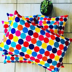 Fun & Playful. Modern Ankara wax Cushions perfect for kids bedroom. Invisible zip for easy cleaning. Dimensions: 65cm x 40cm
