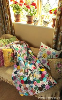 Patchwork and Geraniums in Cottage Sitting Room...Love the color!
