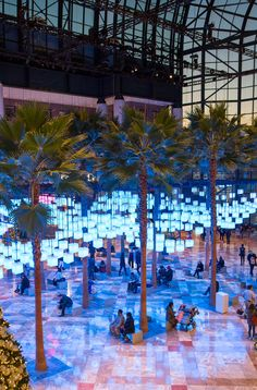 Visitors to this installation can changes the colour of hundreds of suspended illuminated cubes inside an atrium in Lower Manhattan.