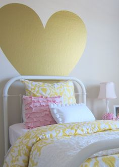 love this girls room with the big gold heart on the wall! pale pink, gold and white.