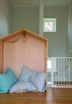 This playhouse is made from plywood, wallpaper, and a pendant light.