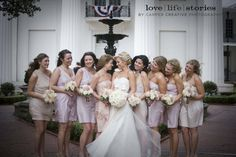 I love the blush pink bridesmaids dresses and the gown is simply stunning. Shot by Carper Creative Photography in Little Rock