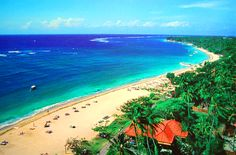 Nusa Dua Beach. Location Bali. Beautiful beaches with white sand. Nusa Dua is known as an enclave of large international 5-star hotels and resorts in south-eastern Bali. It is located 40 kilometres from Denpasar, Bali.