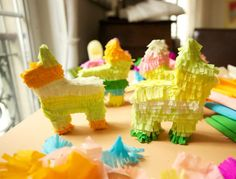 Mini pinatas for each party guest. No more whacking each other over the head for candy-hopefully  : )