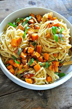 Vegan spicy pasta with roasted sweet potatoes is Fall in a bowl! Cream sauce flavored with chili paste and garlic, roasted sweet potatoes tossed with pasta!