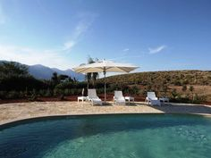 View on the sea and on the coastline of the Zingaro nature reserve from the pool of Villa Elena