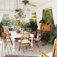 Dress up elegant gatherings with outdoor-fabric curtains and a rustic candle chandelier. Sisal and kilim rugs and a flea-market-find bamboo daybed complete this cabana coastalliving.com
