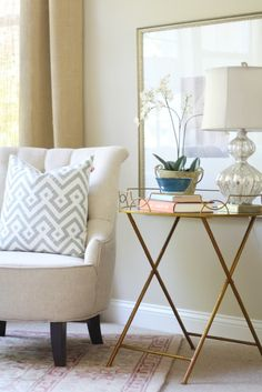Learn Five Ways to Make a Vignette Shine. HomeGoods makes accessorizing easy with finds like this table, lamp, pillow and bowl. #sponsored #happybydesign #homegoodshappy