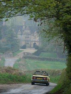 Photograph by David McLain  ~ A 1974 Triumph TR6, a sleek, homegrown convertible painted a yellow as bright as flower-show daffodils, was the author's rental car of choice for his drive through the Cotswolds along country lanes like this one leading to Upper Slaughter.