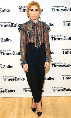 Zosia Mamet in a pattern top and high-waisted back pants
