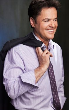 Donny Osmond wearing pastel purple.