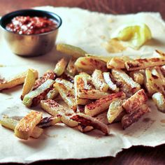 Kohlrabi Fries 2 kohlrabi roots with stems removed (if they come with them) 2 Tbsp. melted coconut oil (I think 1 would be plenty. Also, you could use olive oil) sea salt or kosher salt chili powder & ground cumin Dairy Free Recipes, Vegetable Recipes, Paleo Recipes, Real Food Recipes, Gluten Free, Veggie Box, Recipe Filing, Seasonal Food, Fries In The Oven