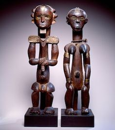 """Fang Artist, Cameroon. Male and Female Reliquary Guardian Figures (19th century). Wood, brass, glass.  Courtesy of the HIGH Museum of Art (ATL):   In the dense equatorial region of central Africa, Fang sculptures like these were carved as guardian figures to sit upon bark boxes containing a family's ancestral relics. As sentinels, the sculptures are upright, frontal, and symmetrical; they are alert and at attention. A Fang elder described how, """"Their faces are strong, quiet, and reflective…"""