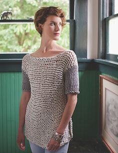 Yarns made from T-shirt jersey seem to have a limited but potent appeal. The obvious choices seem to be home decor and simply knotted accessories. Sweaters have always been deemed improbable, most likely because of the heft of the finished fabric.