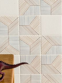 """French designer Inga Sempé partnered with Italian tile manufacturer Mutina for a new collection of graphic tiles, entitled Tratti. -- Pattern """"Triple"""" and base color """"Bianco"""""""