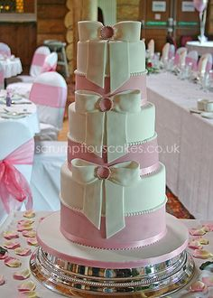 https://flic.kr/p/6bFPM3   Wedding Cake (414) - Double Height Pearls & Sugar Bows   2 x 6 inch, 2 x 8 inch & 2 x 10 cakes stacked on top of each other.