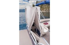 Pop-up changing room w/bench seat & storage net http://www.exclusiveautomarine.com/product/party-barge-20-dlx