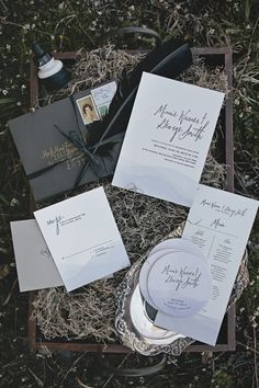 Lake inspired wedding invitations, echoing the ripples of the water. From a dark, modern & slightly gothic, a Lady of the Lake inspired wedding shoot. Images by Sarah Gormley Photography.