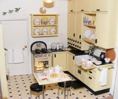 An Art Deco Dolls House made and furnished by Artisans by Jazz - Dolls Houses Past & Present (nice 1930's dolls house kitchen - like the flying ducks!)