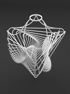 lampshade based on triangles of a tetraeder with recursive programming. Easy to attach to a socket. Design by studioluminaire.com