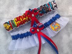 Handmade super hero wedding garters keepsake and toss CAPTAIN AMERICA Marvel Super Hero wedding garter set Keywords: #weddings #jevelweddingplanning Follow Us: www.jevelweddingplanning.com  www.facebook.com/jevelweddingplanning/