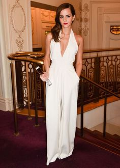 Emma showed off a hint of cleavage thanks to her white halterneck jumpsuit