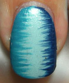 "Deez Nailz: Whispy Whatever-  paint on first color on whole nail. take your two other colors and with your thin nail brush thingy, ""wisp"" your two other colors"